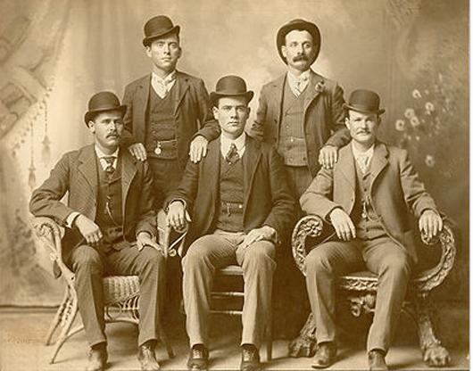 A circa 1900-1901 photo of the 'Wild Bunch' gang, Fort Worth, Texas. Sitting (l to r): Harry A. Longabaugh, alias the Sundance Kid; Ben Kilpatrick, alias the Tall Texan; Robert Leroy Parker, alias Butch Cassidy; Standing (l to r): Will Carver, alias News Carver; and Harvey Logan, alias Kid Curry.