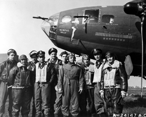 The crew of the B-17 Flying Fortress Memphis Belle is shown at an air base in England after completing 25 missions. Capt. Robert K. Morgan (fifth from left) was the pilot. Image courtesy of Wikimedia Commons.