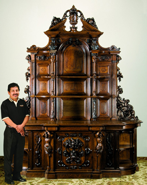 Massive 19th-century carved oak buffet attributed to Alexander Roux, 125 inches high by 105 inches wide. Image courtesy of Great Gatsby's.
