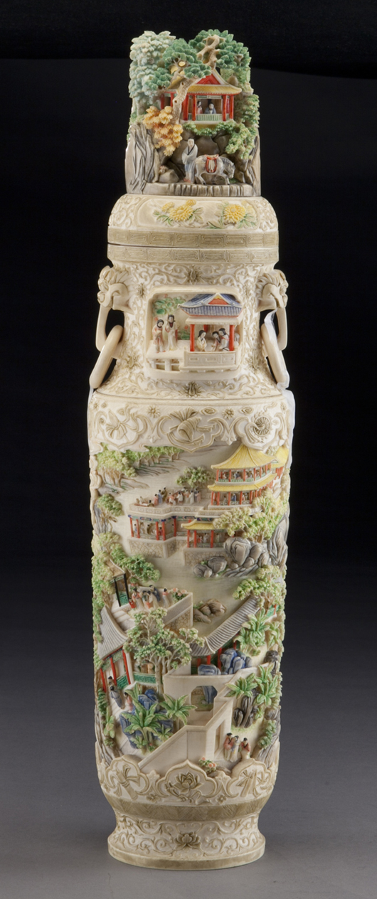 Chinese carved polychrome ivory vase, the finial depicting a mountain scene, the body depicting figures celebrating in a landscape, eight lucky symbols and fruit, with two free rings spouting from lion mask handles. Estimate: $60,000-$80,000. Image courtesy of Dallas Auction Gallery.