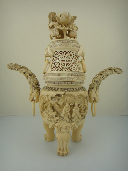 An exceptionally carved ivory tripod censer with longevity 'shou' symbol stands 15 inches high with a six-character Qianlong mark on the base. The features a relief carving of three immortals and a dragon and chicken motif design on the handles. Lot 551 is expected to exceed its high estimate of $7,000. Image courtesy of 888 Auctions.