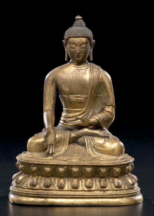 Sino-Tibetan gilt bronze Buddha, 6 1/2 inches: $20,400. Image courtesy of Cowan's Auctions.