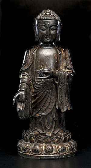 Chinese bronze standing Buddha, 24 1/4 inches: $102,000. Image courtesy of Cowan's Auctions.