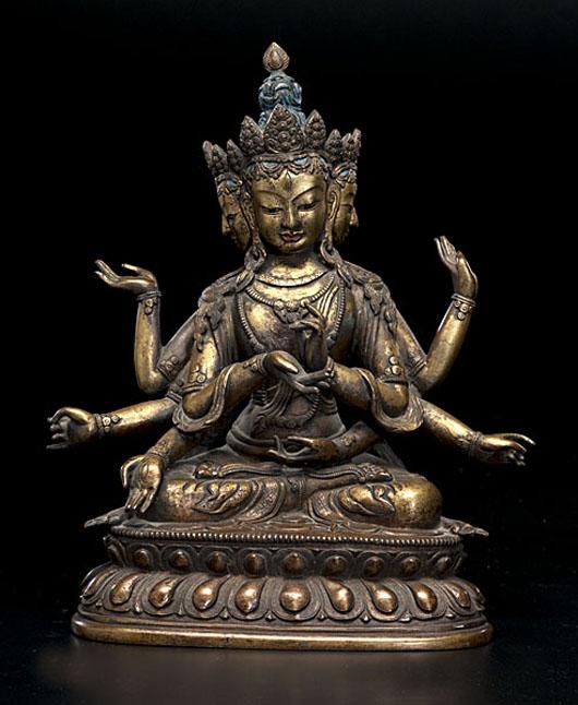 Sino-Tibetan bronze Buddha, 15 1/2 inches:  $54,000. Image courtesy of Cowan's Auctions.