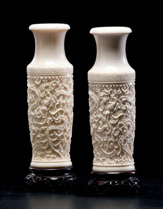 Pair of Chinese carved ivory vases on stands, each 7 inches including stands: $8,400. Image courtesy of Cowan's Auctions.