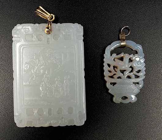 Two Chinese white jade pendants, the larger 2 inches long: $49,937.50. Image courtesy of Cowan's Auctions.