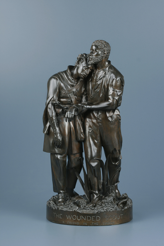 'Wounded Scout, A Friend in the Swamp' from 1863 was one of the first representations of a common humanity which transcends racial divisions. The bronze sculpture is on the catalog cover of 'John Rogers: American Stories,' a traveling exhibition organized by the New-York Historical Society. Image courtesy of New-York Historical Society.