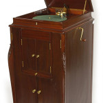 This Victor 'L-door' phonograph, Style VV-XVI, has a carved mahogany case. Image courtesy of LiveAuctioneers Archive and Forsythes' Auctions LLC.