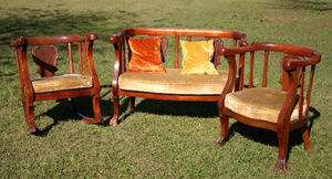 """This Empire Revival parlor set, circa 1895-1900, is made of solid birch with a """"simulated mahogany"""" finish to match the mahogany veneer in the splats. Image courtesy of LiveAuctioneers Archive and Turkey Creek Auctions."""