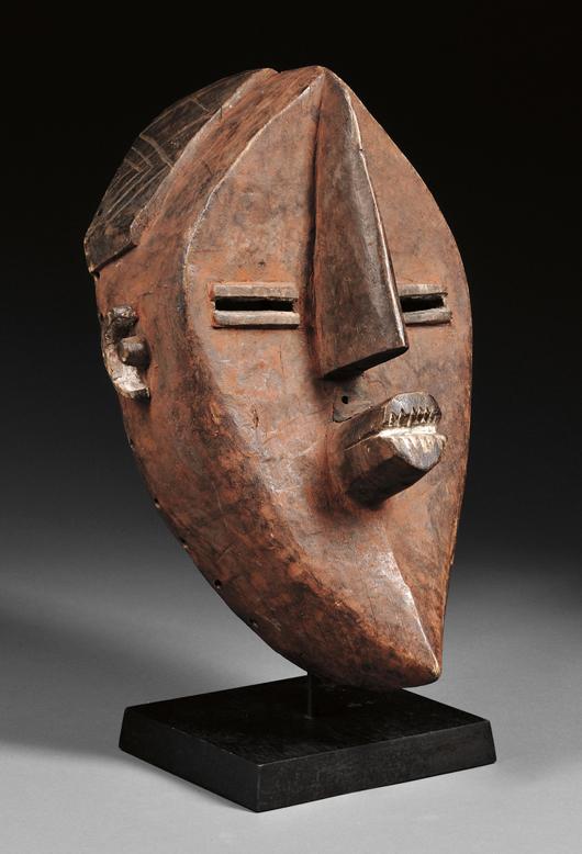 Lwalwa carved wood mask, Democratic Republic of Congo, est. $2,500-$3,500. Image courtesy of Skinner Inc.