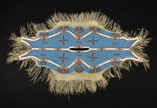 Lakota beaded hide dress yoke, circa last quarter 20th century. Provenance: Collected by Mrs. Luke C. Walker. Est. $8,000-$12,000. Image courtesy of Skinner Inc.