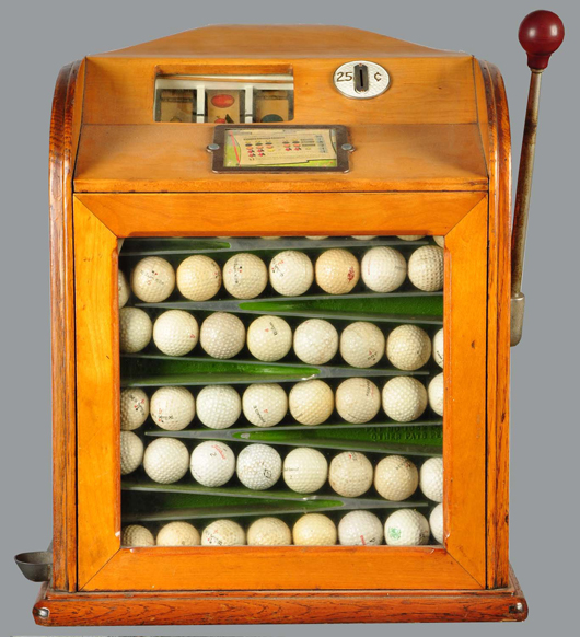Jennings wood-cased 25-cent slot machine that pays off in golf balls, $14,400. Morphy Auctions image.