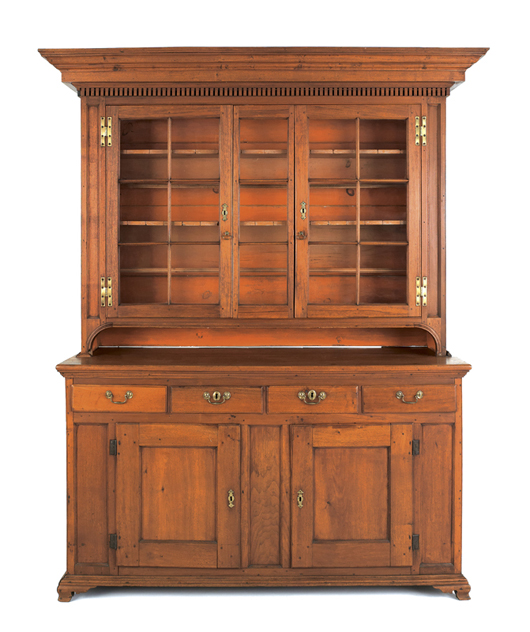Lancaster, Pa., Chippendale walnut wall cupboard, circa 1770, original salmon paint, ogee bracket feet, 87 1/2 inches high, 60 1/2 inches wide, 21 1/2 inches deep. Estimate:$15,000-25,000. Image courtesy of Pook & Pook Inc.