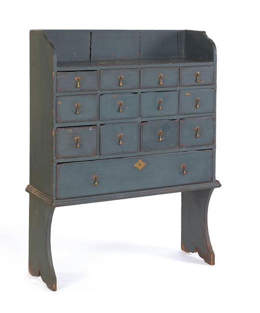 New England painted pine apothecary cupboard, mid-18th century, with 13 drawers and bootjack feet, 50 inches high, 36 1/2 inches wide. Estimate: $5,000-$8,000. Image courtesy of Pook & Pook Inc.