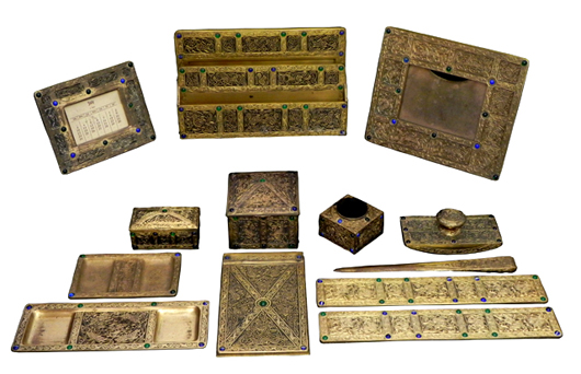 Tiffany bronze desk sets, including a 13-piece set in the Ninth Century pattern, will be sold. Image courtesy of Crescent City Auction Gallery.