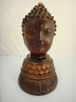 18th century Chinese rhinoceros horn carved as a two-faced Buddha head, $49,610 against a high estimate of $30,000. 888 Auctions image.
