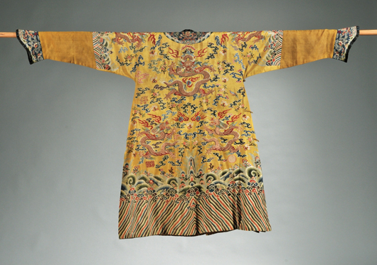 Tapestry weave robe, China, late 19th century, Ko'ssu dragon robe, mustard color with gold thread dragons. Estimate $10,000-15,000. Image courtesy of Skinner Inc.