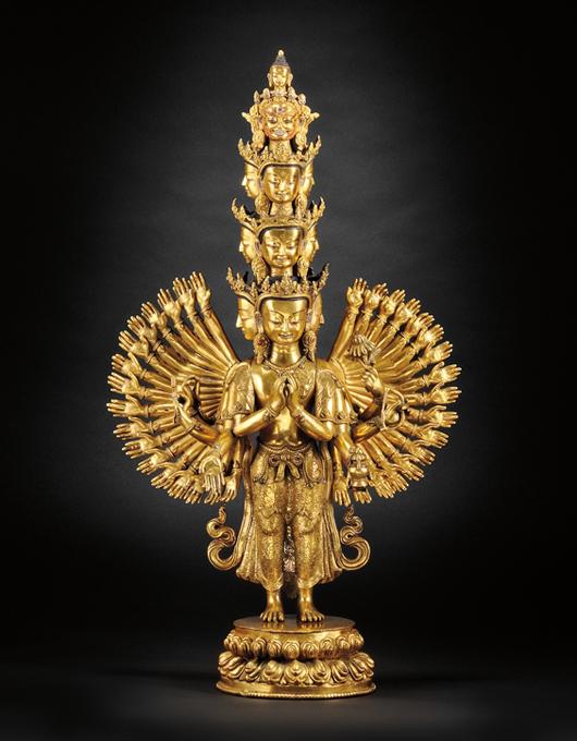 Gilt-bronze Avalokiteshvara, Sino-Tibetan, 18th century, the 11-headed thousand-armed divinity, 22 3/4 inches high. Estimate $6,000-8,000. Image courtesy of Skinner Inc.