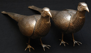 Pair of early 19th century German-made silver pheasant bird vessels (est. $4,000-$6,000). Image courtesy of Elite Decorative Arts.
