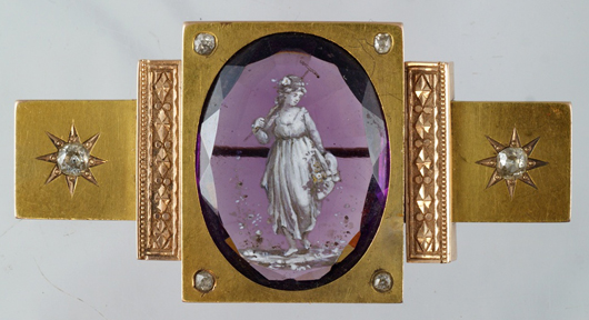 Yellow gold Victorian brooch set with 28mm by 20mm enameled, faceted amethyst. William H. Bunch Auctions ima