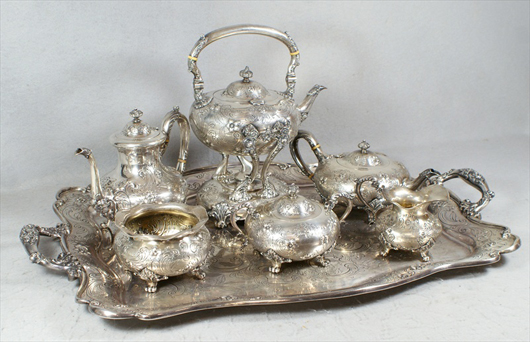 1908 Dominick & Haff engraved and repousse sterling silver teaset. William H. Bunch Auctions image.