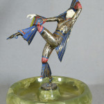 Enameled and silvered-bronze Gerdago Art Deco dancer with ivory face and hands, dished green alabaster base, 11 inches tall. William H. Bunch Auctions image.