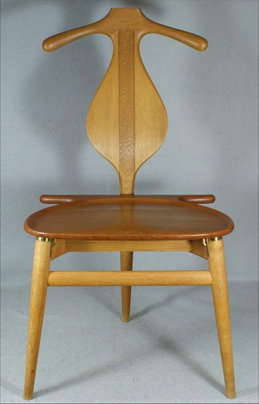 """Hans J. Wegner/Johannes Hansen """"Valet"""" chair, Danish, designed 1953, has branded mark. William H. Bunch Auctions image."""