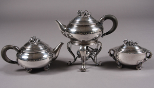 Georg Jensen silver partial tea service comprised of a teapot, tea kettle and covered sugar. Est. $8,000-$12,000. Image courtesy of Stefek's.
