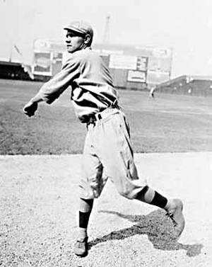 A Chicago Daily News photo shows Boston Red Sox rookie pitcher Babe Ruth warming up in 1914. Image courtesy of Wikimedia Commons.