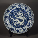Important and rare Chinese Ming Dynasty porcelain charger with central reverse design of writhing five-toed dragon amid crashing waves. Estimate: $150,000-250,000. Image courtesy of 888 Auctions.
