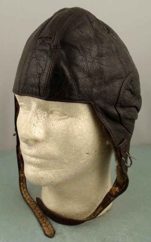 Original Nazi Luftwaffe flight helmet, brown leather with fur lining, est. $400-$620. Universal Live image.