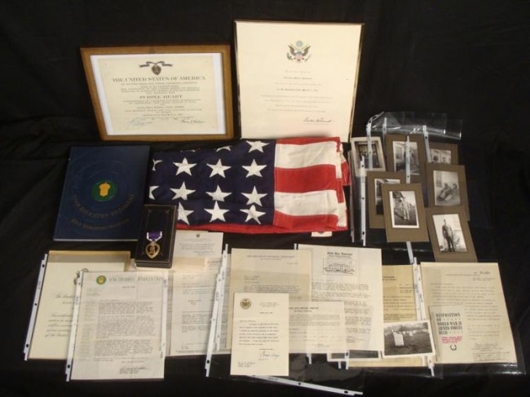 Purple Heart and military archive of U.S. soldier killed in action during World War II, est. $1,590-$2,440. Universal Live image.