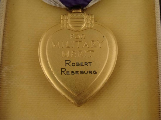 Closeup of Purple Heart Medal from U.S. soldier's World War II archive. Universal Live image.