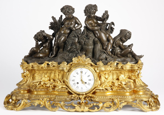 Fully chased 19th century bronze Bacchus-themed putti clock. Image courtesy of Great Gatsby's.
