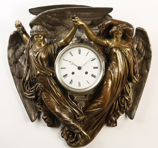 """Nineteenth century gilt bronze figural clock, maker marked """"Barbedienne & Cie."""" Image courtesy of Great Gatsby's."""