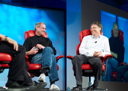 Steve Jobs (left) and his old friend and business adversary Microsoft chairman/former CEO Bill Gates at the D5: All Things Digital conference in Silicon Valley in 2007. Photo by Joi Ito of Inbamura, Japan; licensed under the Creative Commons Attribution 2.0 Generic license.