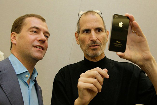 Steve Jobs (right) demonstrates the iPhone 4 to Russian president Dmitry Medvedev, June 23, 2010. Copyrighted photo from the website of the President of the Russian Federation, licensed under the Creative Commons Attribution3.0Unported License. Courtesy www.kremlin.ru.