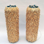 Unique pair of porcupine (or 'feathered' wood) floor lamps, estimated to make $800 or more.