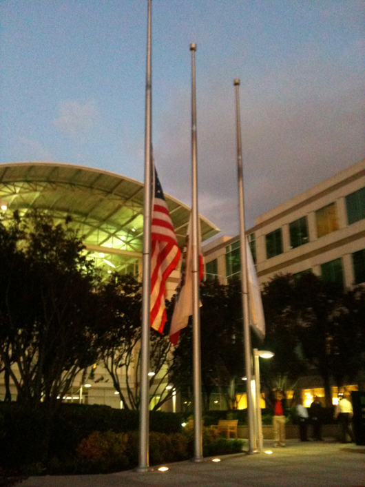 Three flags - American, State of California, Apple Inc. - were lowered to half-mast on the evening of the Oct. 5, 2011 death of Apple co-founder Steve Jobs. Photo by Alison Cassidy, licensed under the Creative Commons Attribution-Share Alike 3.0 Unported license.