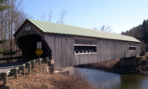 The Bartonsville covered bridge, built in 1870 by Sanford Granger, was a lattice truss style bridge with a 151-foot span across the Williams River. Image courtesy of Wikimedia Commons.