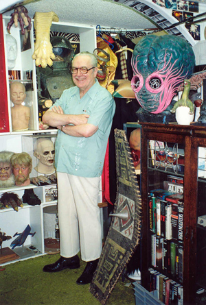 The late Forrest J. Ackerman, surrounded by part of his collection at the 'Ackermansion.' Image courtesy of Wikimedia Commons.