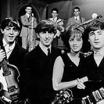 Paul McCartney, George Harrison, Swedish singer Lill-Babs and John Lennon on the set of the Swedish TV show 'Drop-In' in 1963. Pressens Bild image, courtesy of Wikimedia Commons.