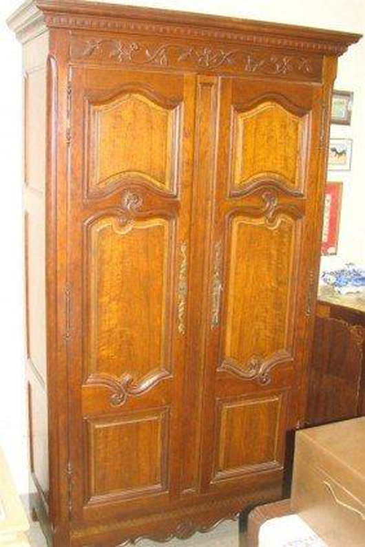 Signed Baker armoire, lot 708. Image courtesy of Professional Appraisers & Liquidators.