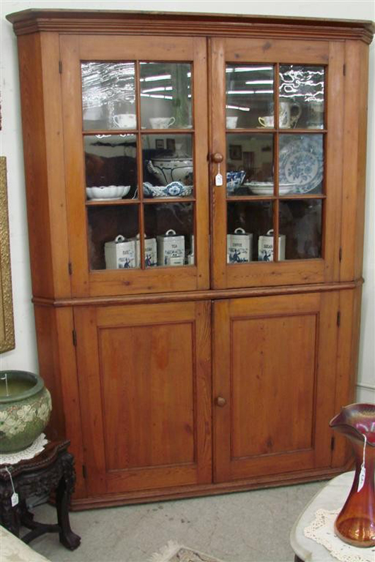 19th century Southern yellow pine two-piece corner cabinet, lot 97. Image courtesy of Professional Appraisers & Liquidators.