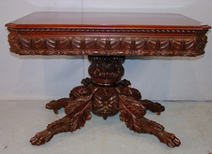 Federal mahogany acanthus carved game table with solid carving to the base top to bottom. Image courtesy of Stevens Auction Co.