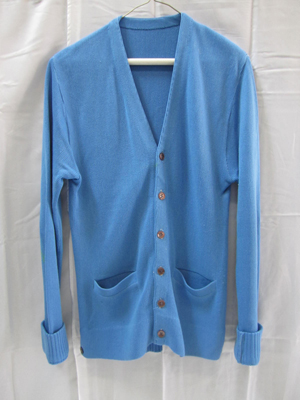 Jack Kevorkian's signature blue cardigan sweater. Image courtesy of Hutter Auction Galleries.