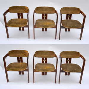 A set of six Tobia and Scarpa chairs. Their co-joined back legs give the effect of a triangulated base. Image courtesy of Roland Auction.
