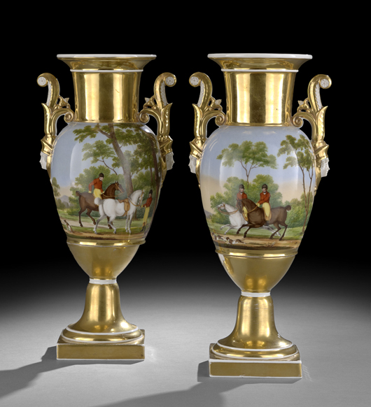 Handled vases, usually made in sets for mantel display, were produced by all the Parisian porcelain firms. This Charles X period pair, painted with lively hunt scenes, brought $2,214 at auction. Courtesy New Orleans Auctions Galleries.