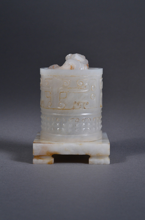 Rare and fine 18th-century Chinese early Qing Dynasty imperial white jade seal of cylindrical form surmounted by an openwork relief carved dragon finial. Image courtesy of 888 Auctions.