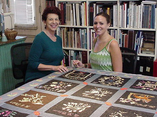 Jessica Hack (left), owner of Jessica Hack Textile Restoration, and associate conservator Nicole Blais, who did a lot of the actual treatment on the quilt. Image courtesy of Jessica Hack Textile Restoration.